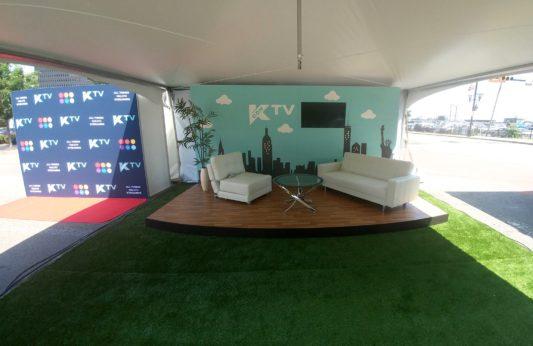 Kcon custom TV set and stage exhibit rental inside tent outdoor