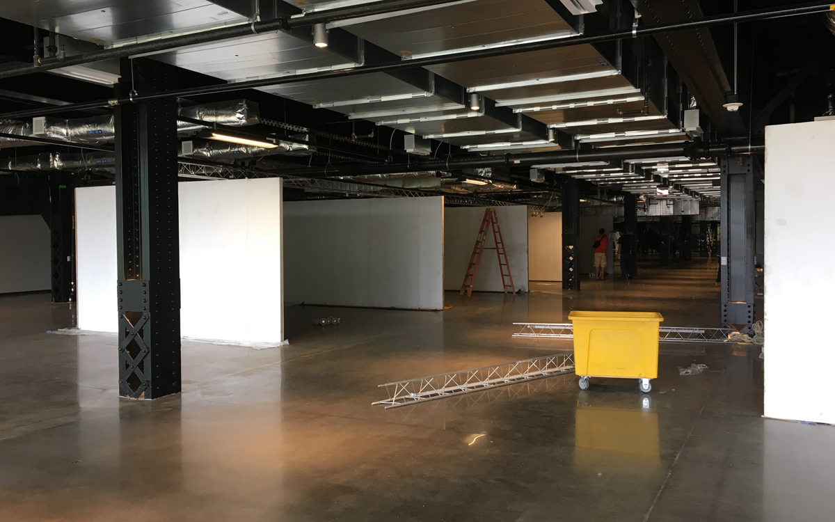 Installation of rental display walls with truss lighting in urban setting