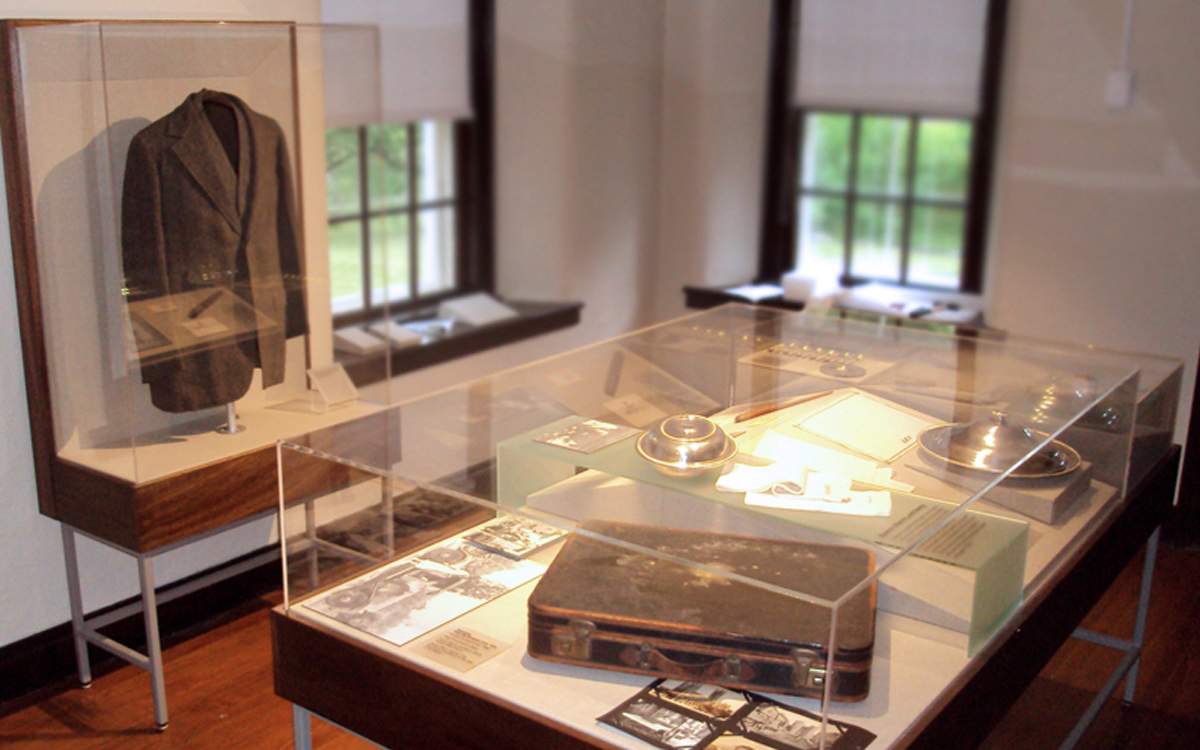 Custom display cases with acrylic vitrines which display historical items and a jacket at the Eleanor Roosevels Val-Kill Cottage museum permanent installation