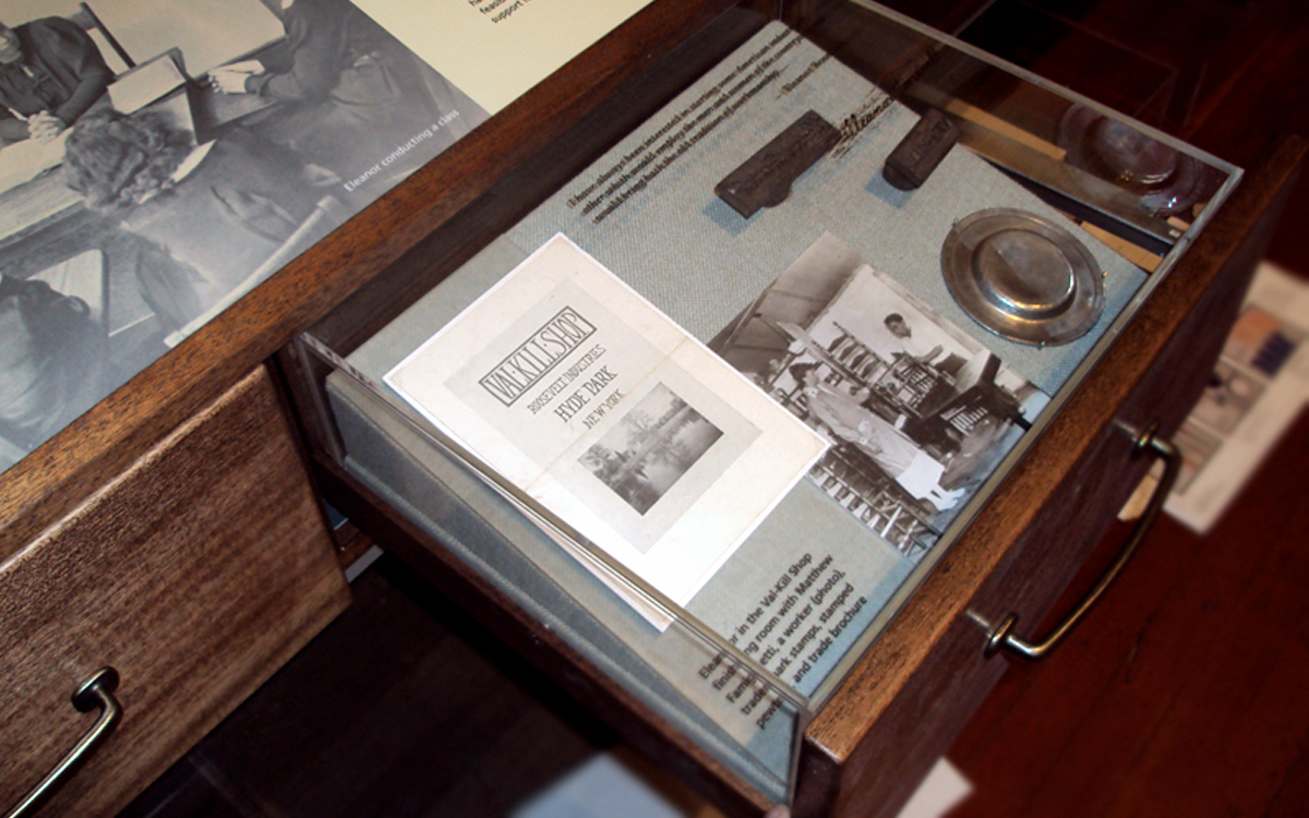 Custom vitrine over open drawer to protect historical items in the Eleanor Roosevelt Cottage