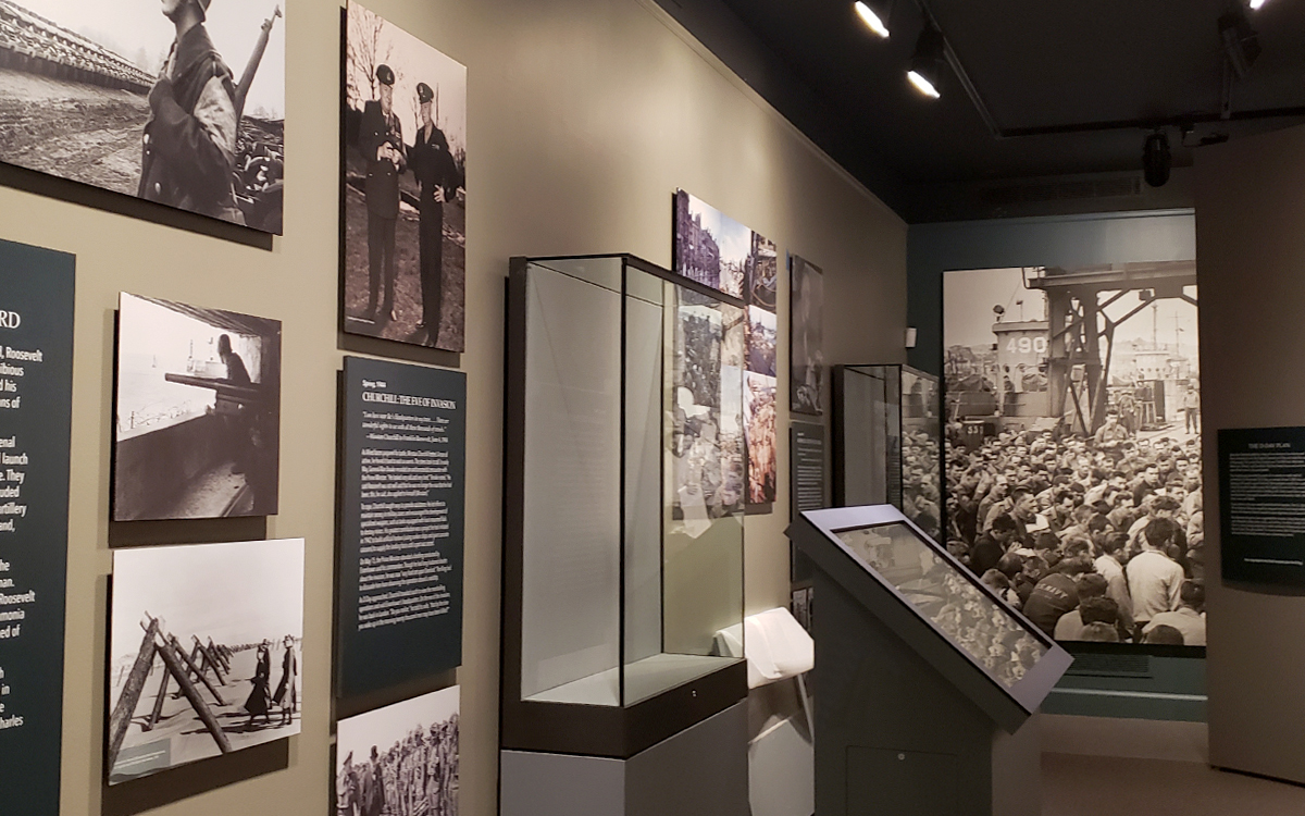 Museum exhibit custom display cases, interactive kiosk, with acrylic vitrines and wall graphic panels for an exhibit at the FDR Presidential Library and Museum