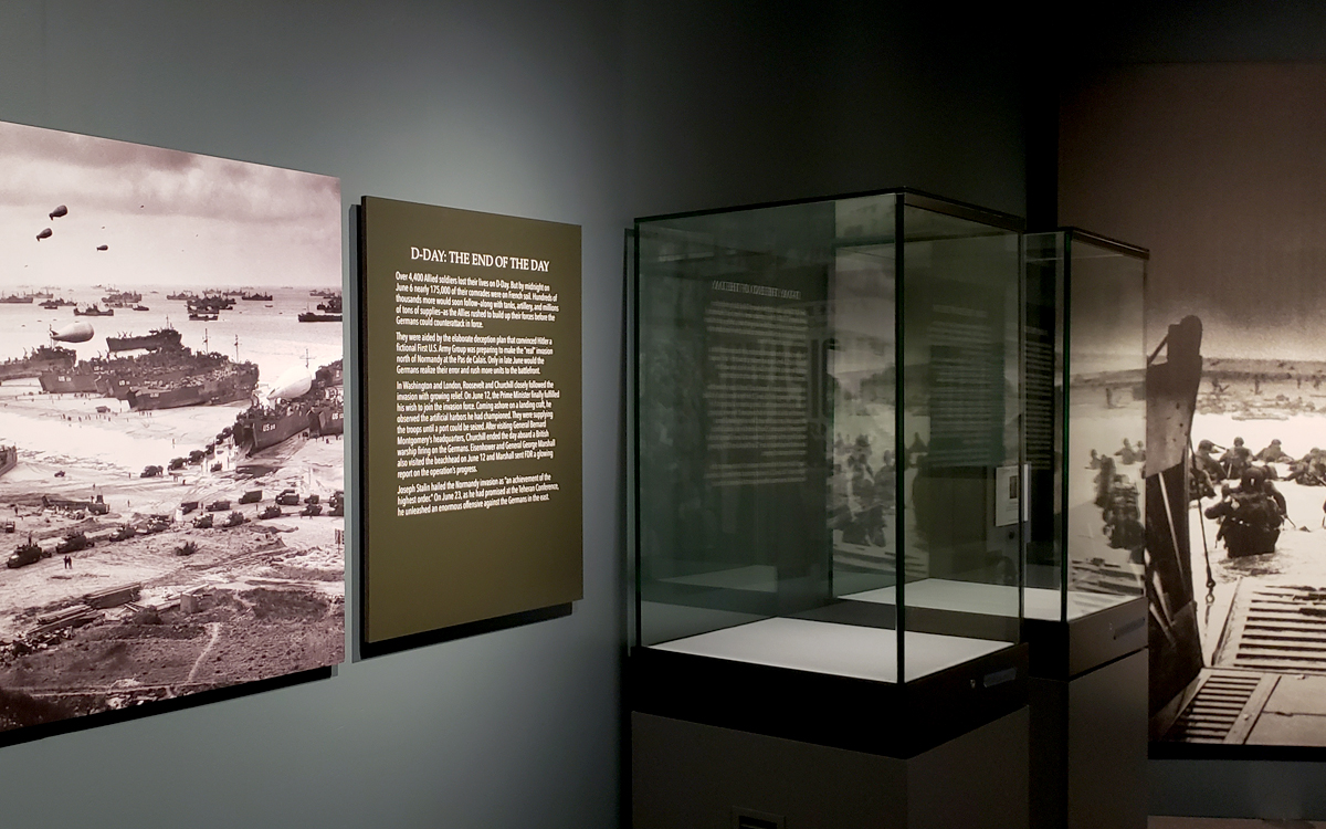 Museum exhibit custom display cases with acrylic vitrines and wall graphic panels for an exhibit at the FDR Presidential Library and Museum