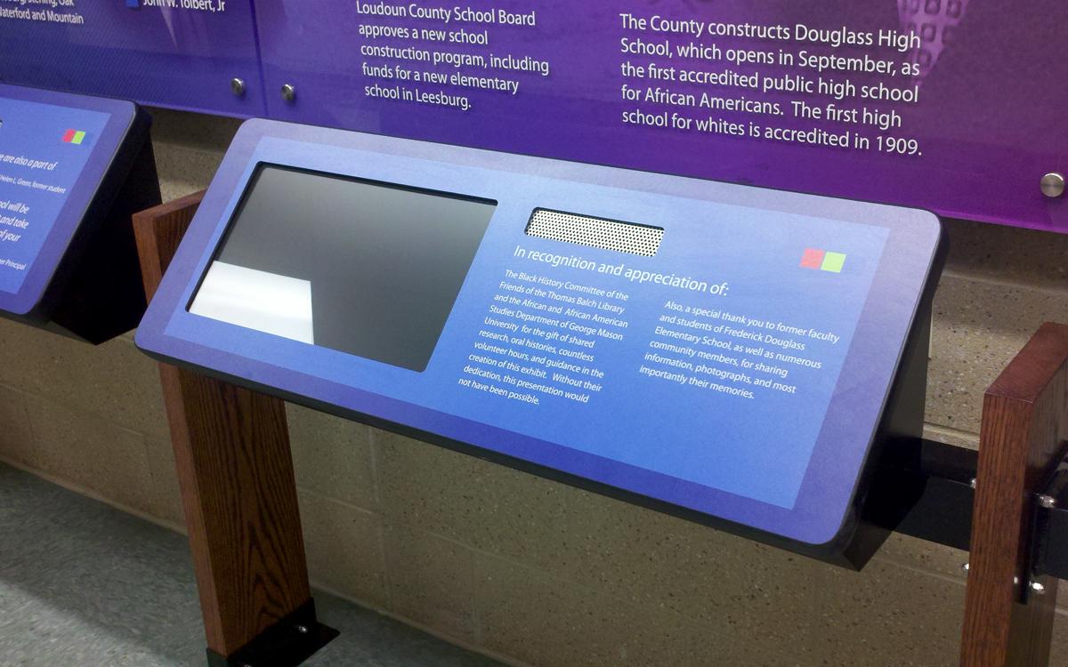 Blue custom kiosk with monitor and dedication