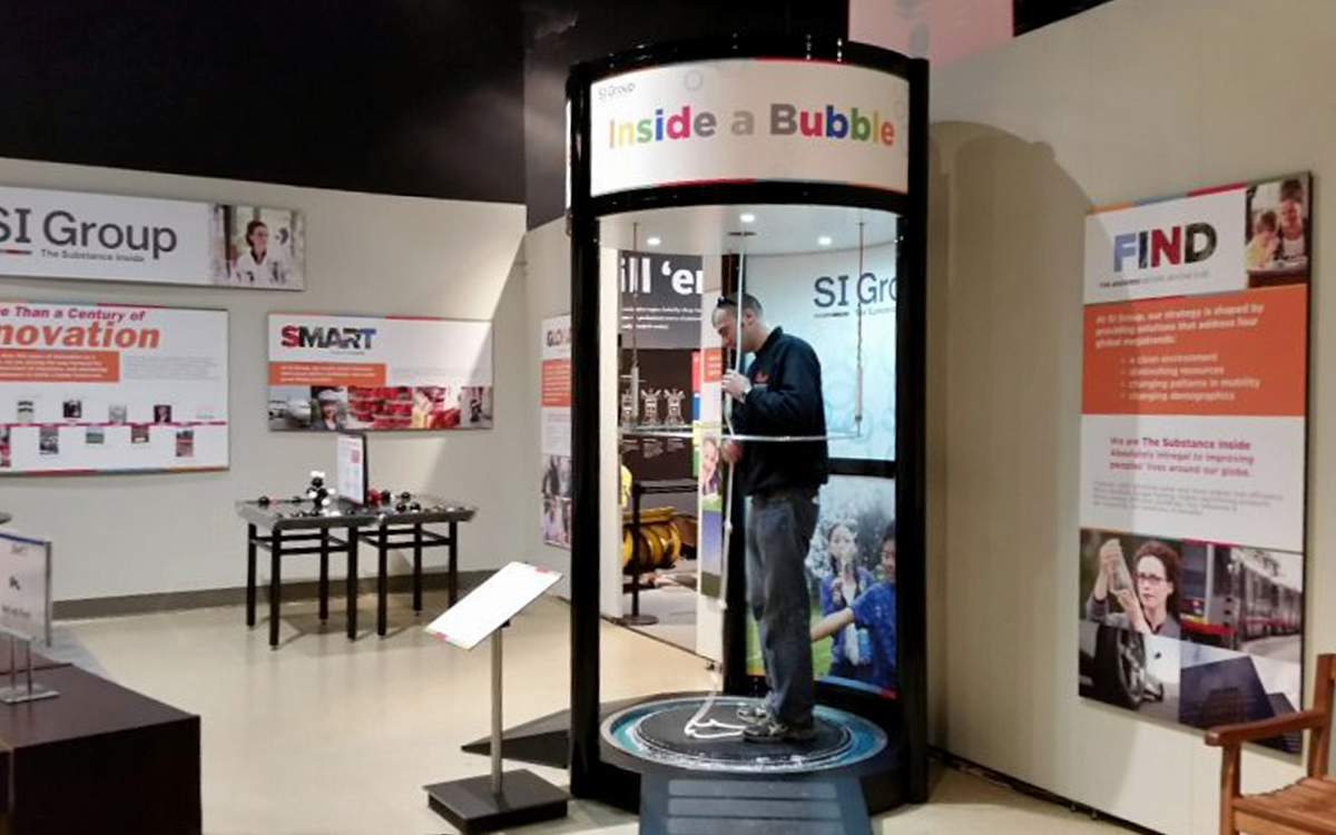 Bubble machine custom interactive kiosk for children to stand inside tube and create a soap bubble around themselves