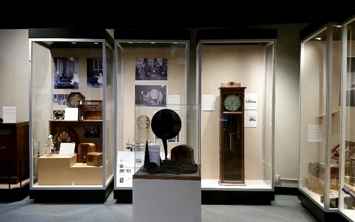 Custom display cases with hidden puck lighting within. Cases display a grandfather clock, listening horn and other artifacts
