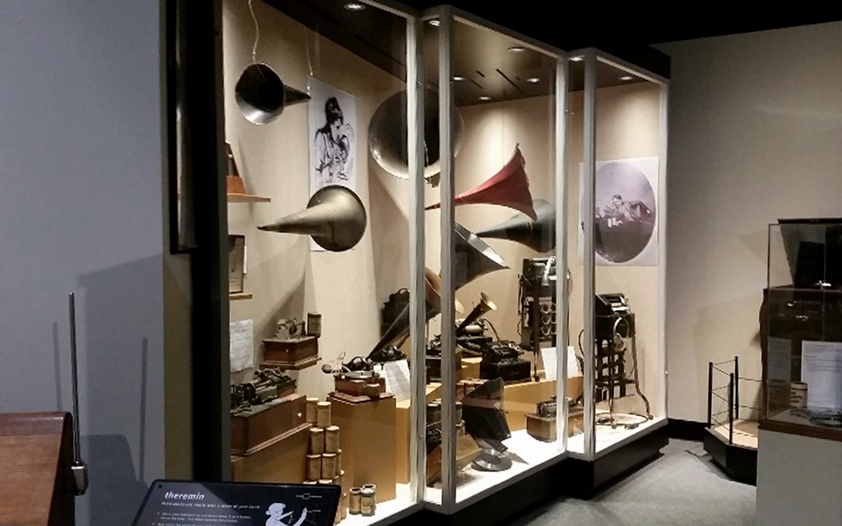 Custom display cases with hidden puck lighting within. Cases display listening horns and other hearing themed artifacts