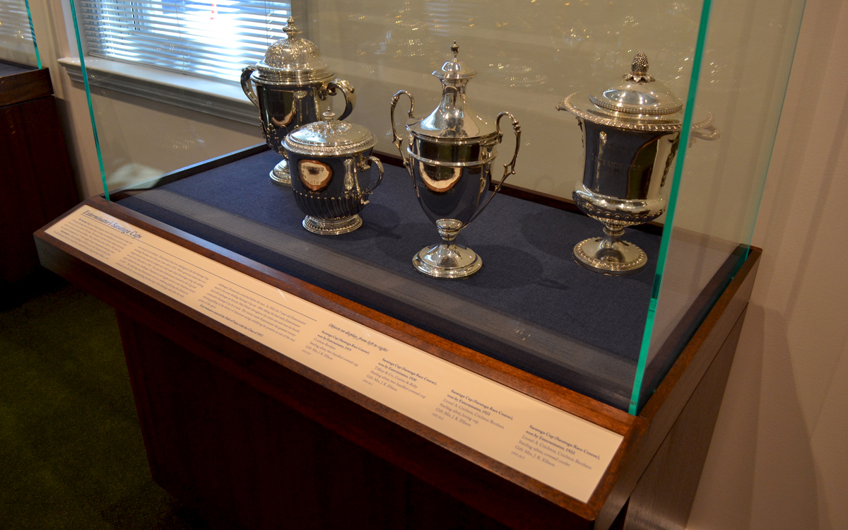museum case holding trophies by empire exhibits