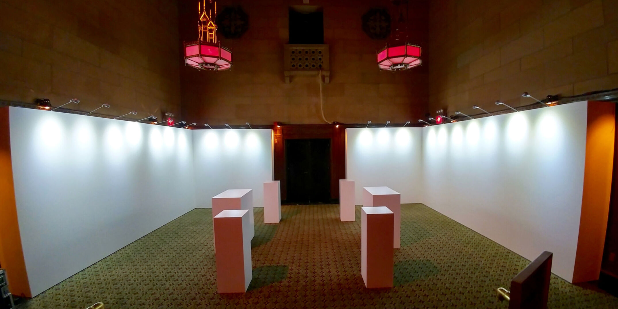 Rental gallery walls and pedestals with stem lights for art exhibit