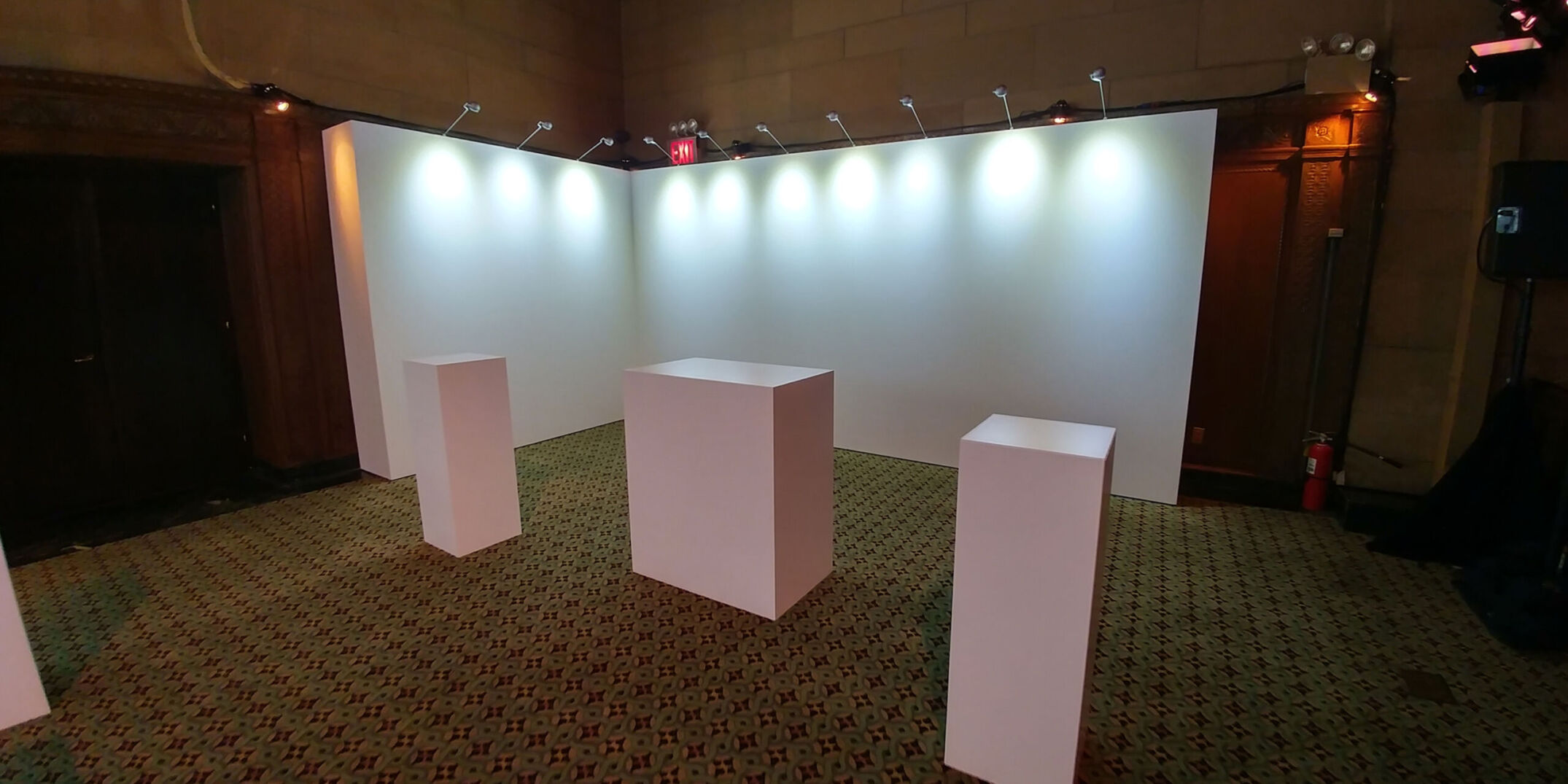 Rental gallery walls and pedestals with stem lights