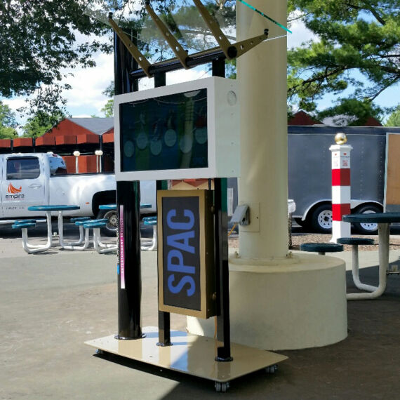 Empire Exhibits truck at the install of the SPAC interactive kiosk. Kiosk has color changing lights, monitor and acrylic roof. It is on casters for portability and was made for the Saratoga Performing Arts Center's 50th anniversary