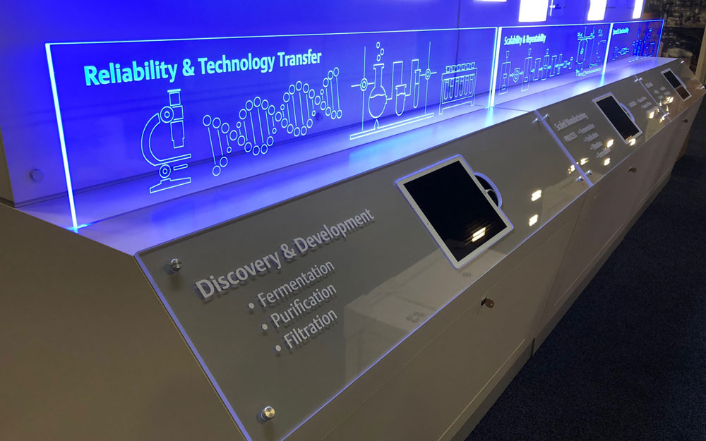 Interactive kiosk with touchscreen monitors and blue LED lighting