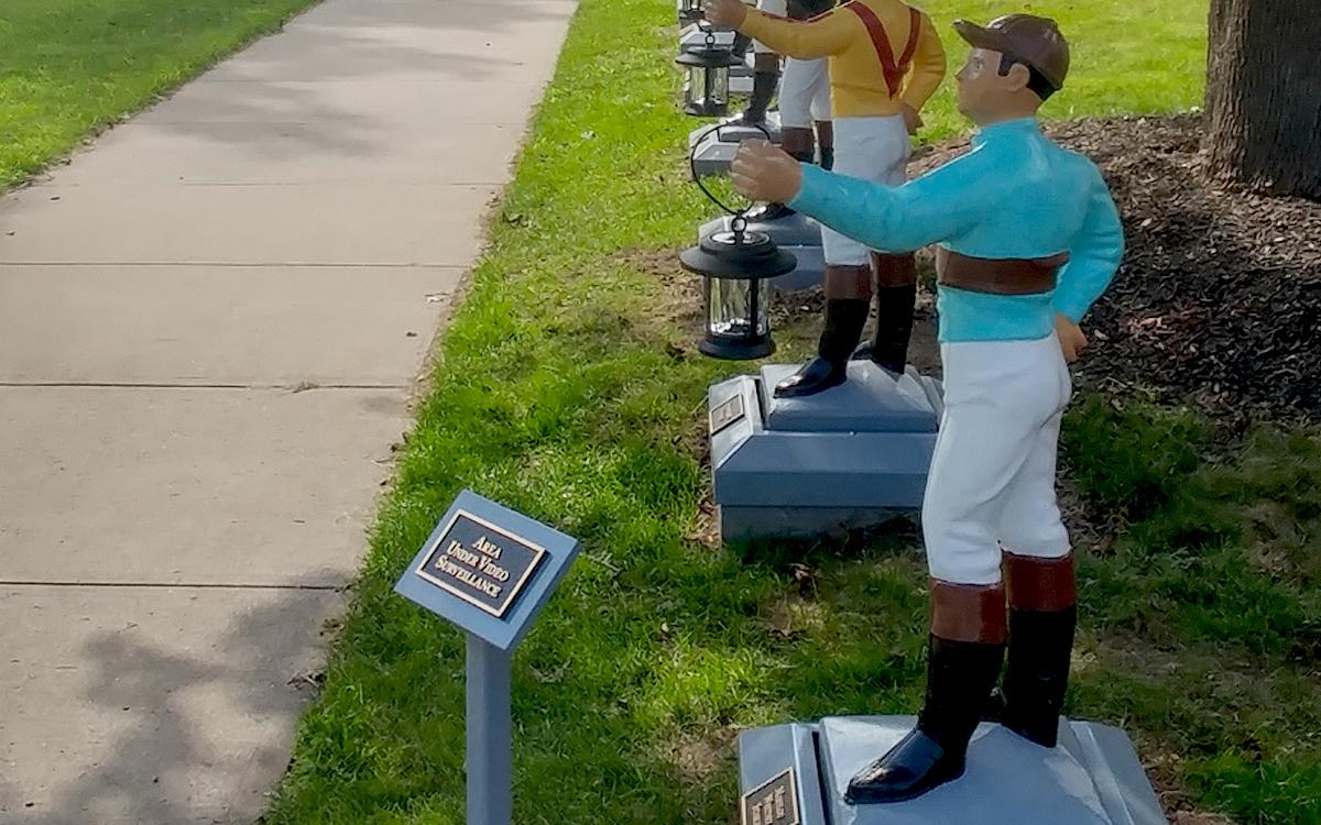 museum exhibit of a row of jockey sculptures