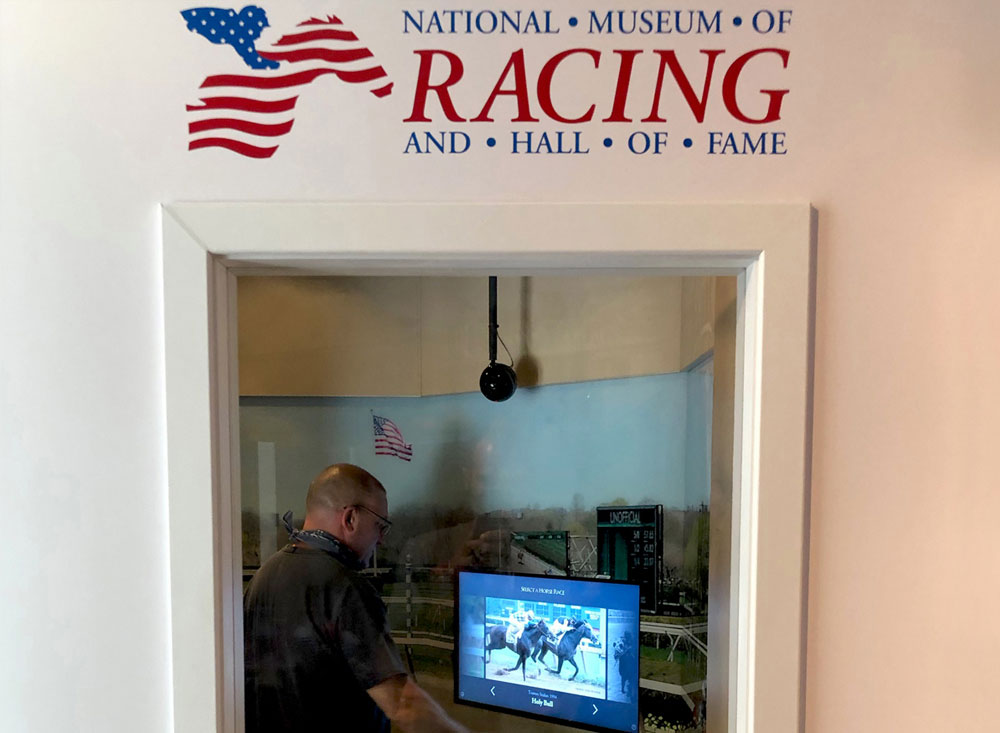 sound booth interactive kiosk at horse racing museum photo op window
