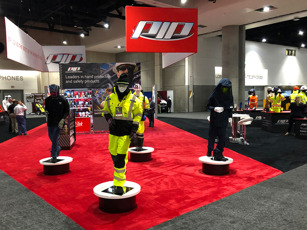 trade show booth with mannequins