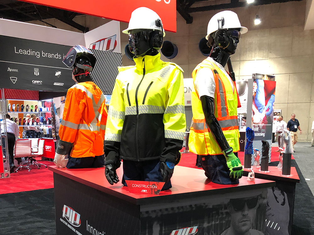 construction mannequins at convention booth