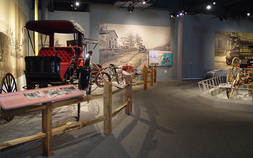Buggy protected by custom built wood railings, reading rails and graphic panels for permanent installation in the America on Wheels Museum exhibit