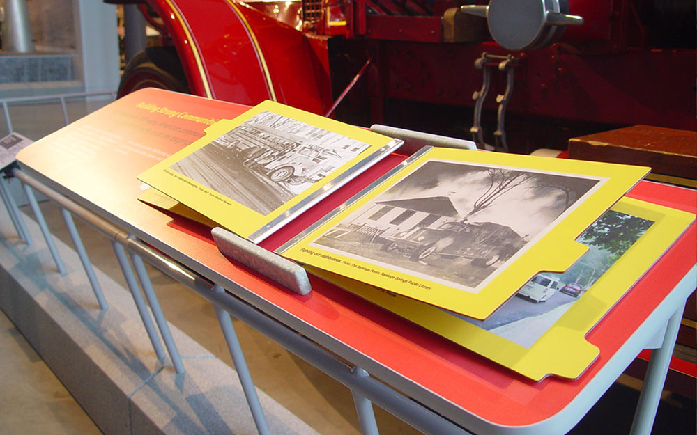 Interactive reading rail display for the America on Wheels museum permanent installation