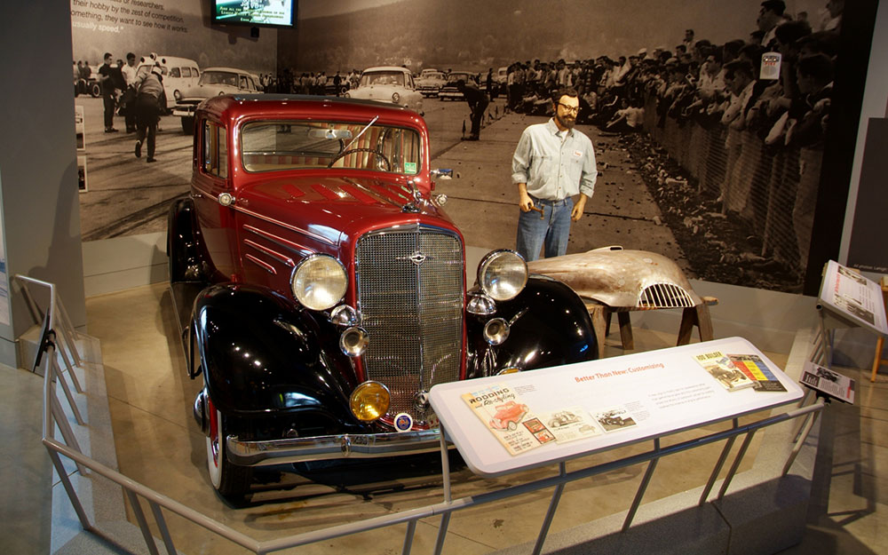 Mannequin, hot rod and reading rail at the America on Wheels Museum Exhibit