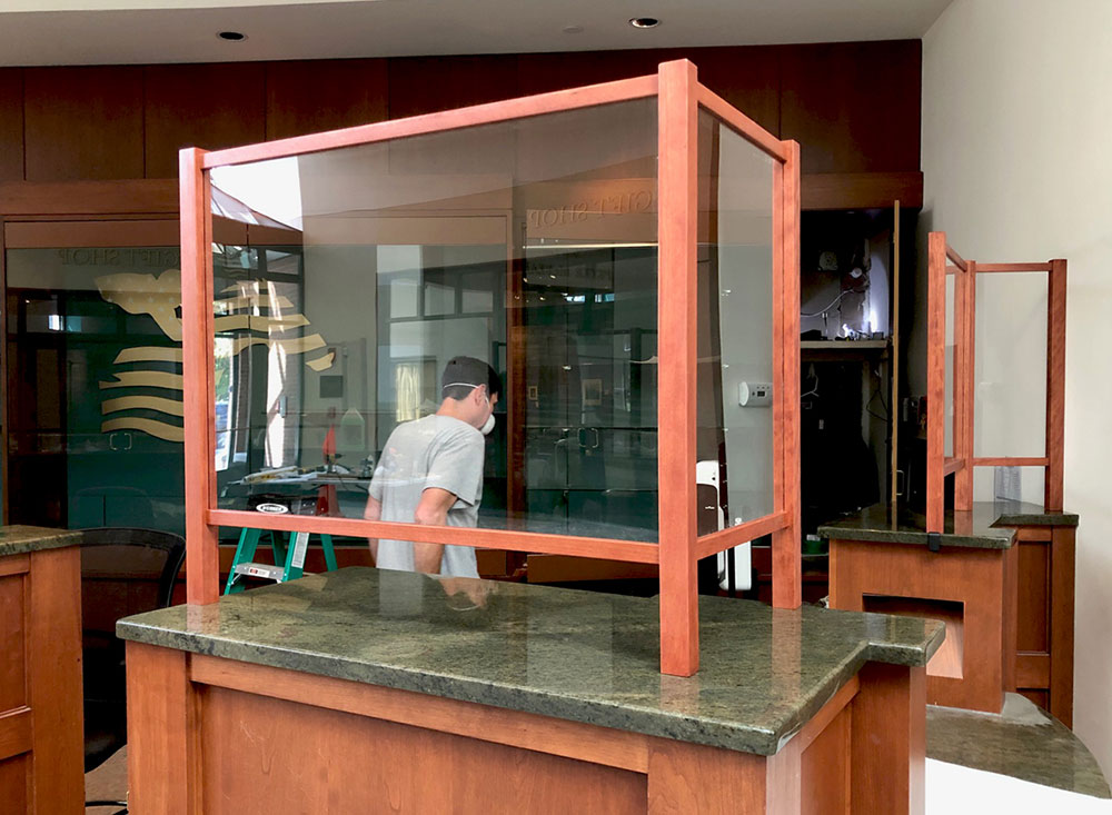 Acrylic PPE protective shields mounted with cherry wood to granite counters