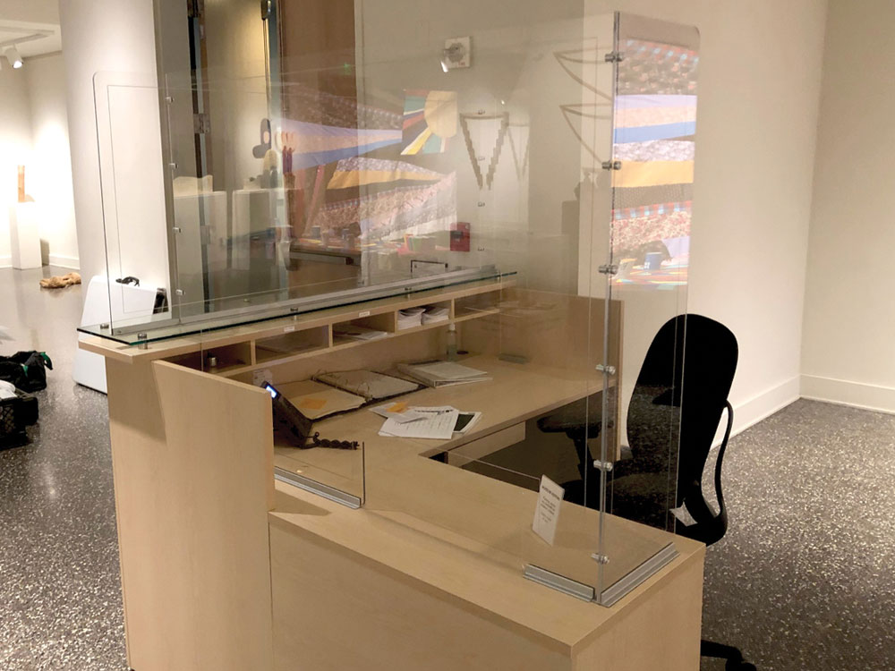 custom sneeze guard protector shield for museum welcome desk