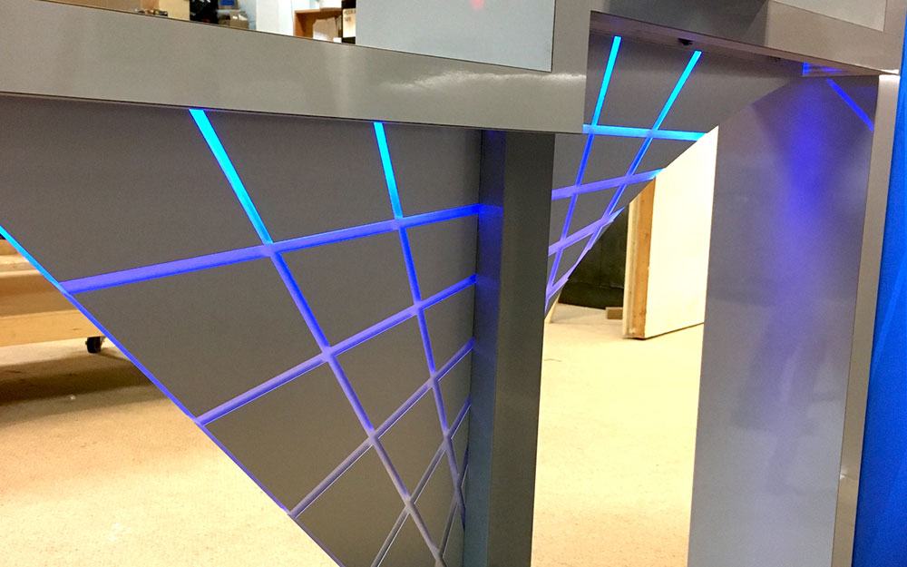 logo inspired LED lighting on trade show booth