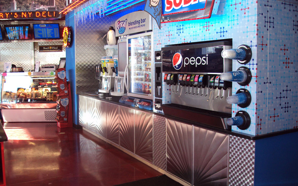 Custom environment and store fixtures for Flory's Deli including backlit icicles, neon signs, custom wall paper and chrome wall panels