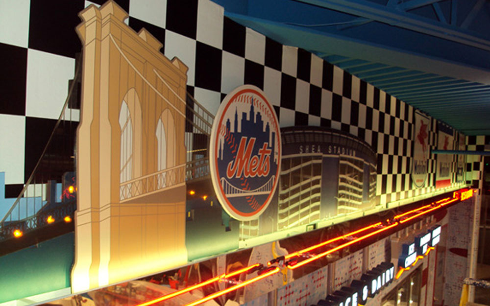 Skyline graphic with neon lighting at Flory's Deli