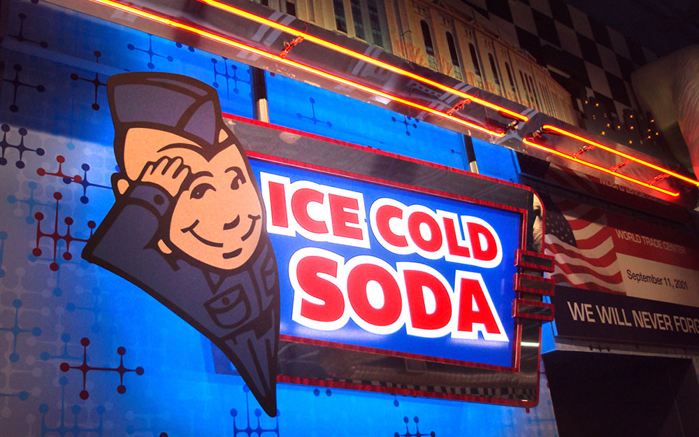 Ice Cold Soda sign with cartoon and custom blue lighting for Flory's Deli
