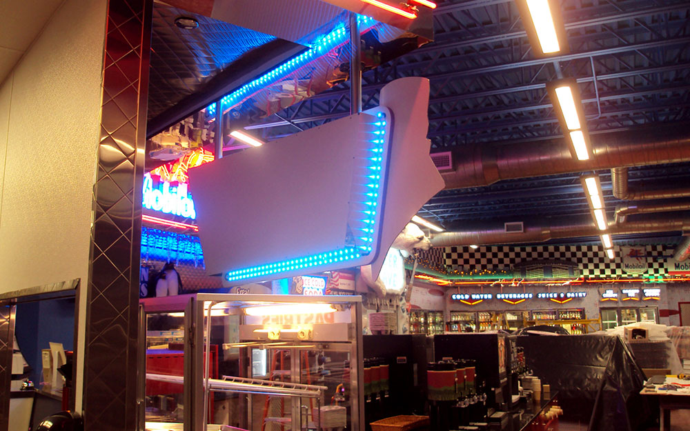 Installation photo of 1950s themed deli decor and store fixtures fabricated and installed by Empire Exhibits