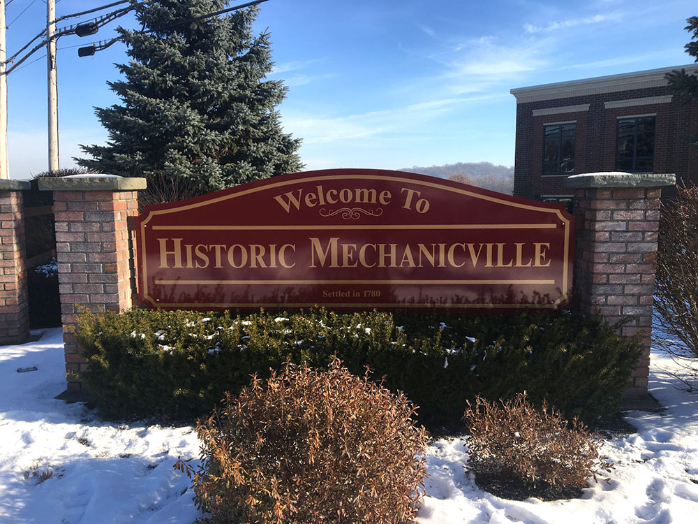 Exterior sign reading Welcome to Historic Mechanicville
