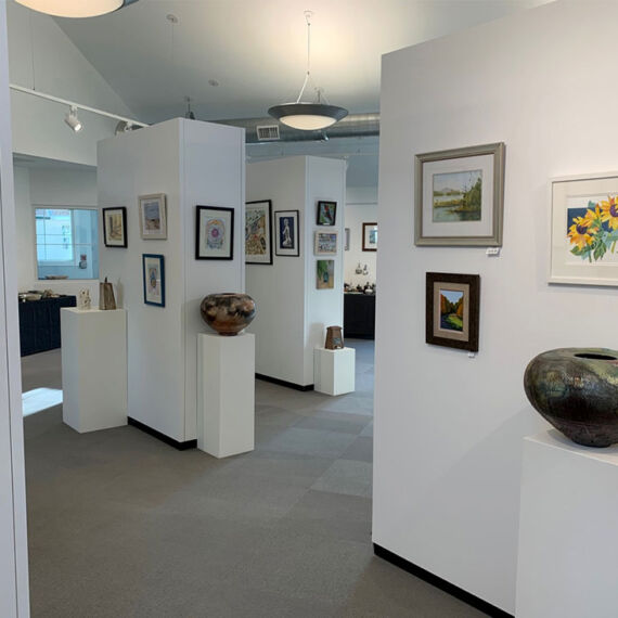Rental Walls and pedestals with hanging art and pottery displays at Monmouth County