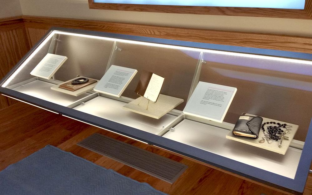 angular custom lighted display case holding artifacts