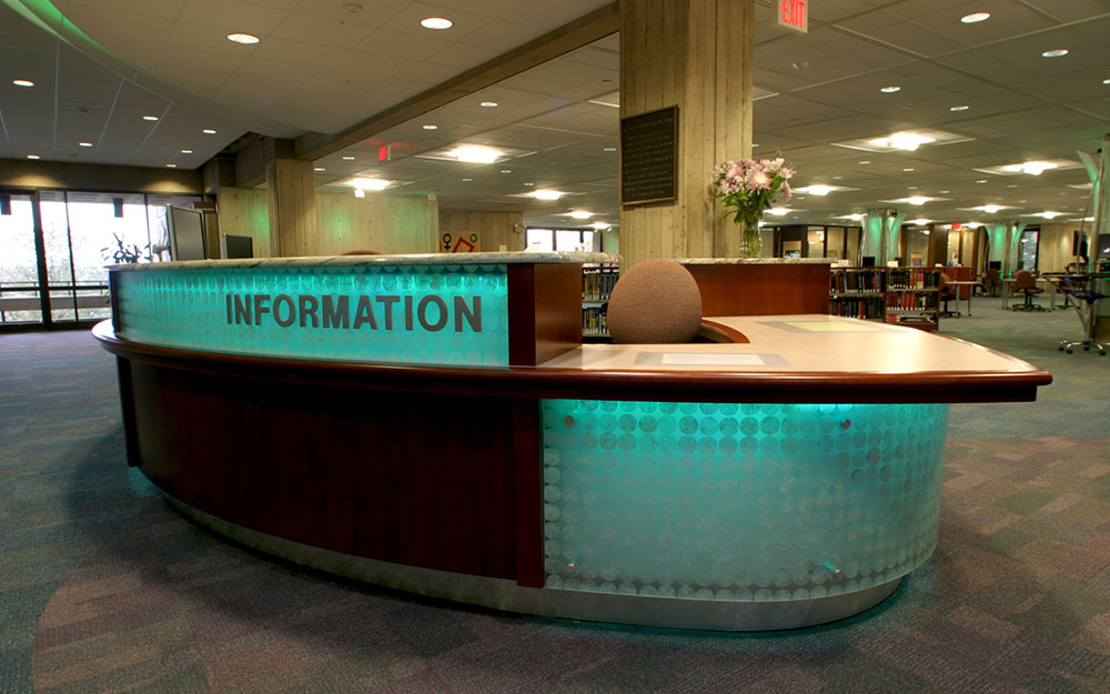 Custom built desk with backlights, granite and rich wood in the Folsom Library at RPI