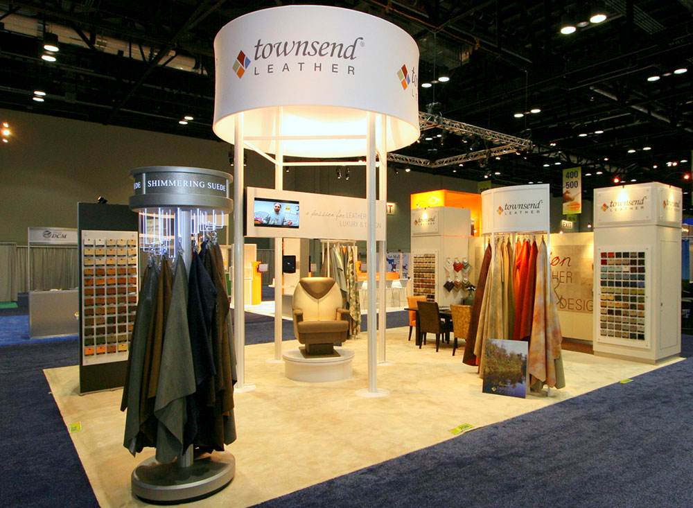 Trade show exhibit booth with fabric skinned tower, sample racks and custom lighting for Townsend Leather