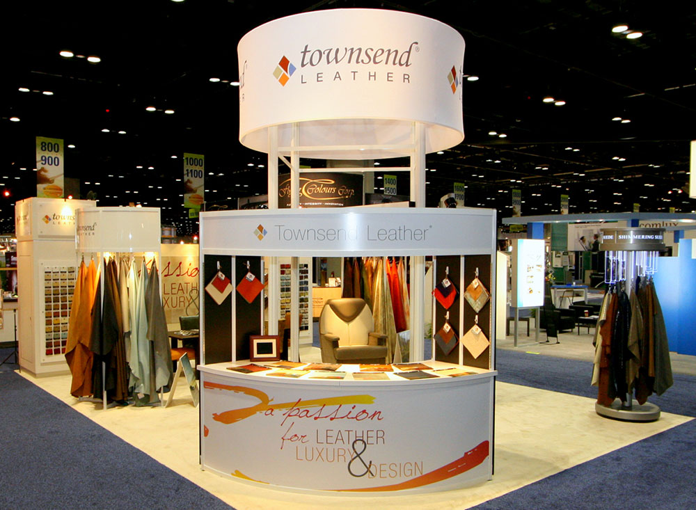 Trade show exhibit booth with graphic tower and curved info desk for Townsend Leather